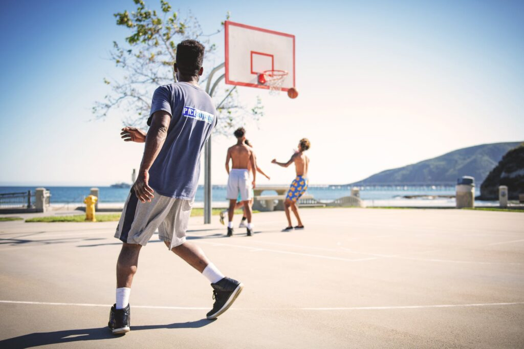 people playing basketball in shorts