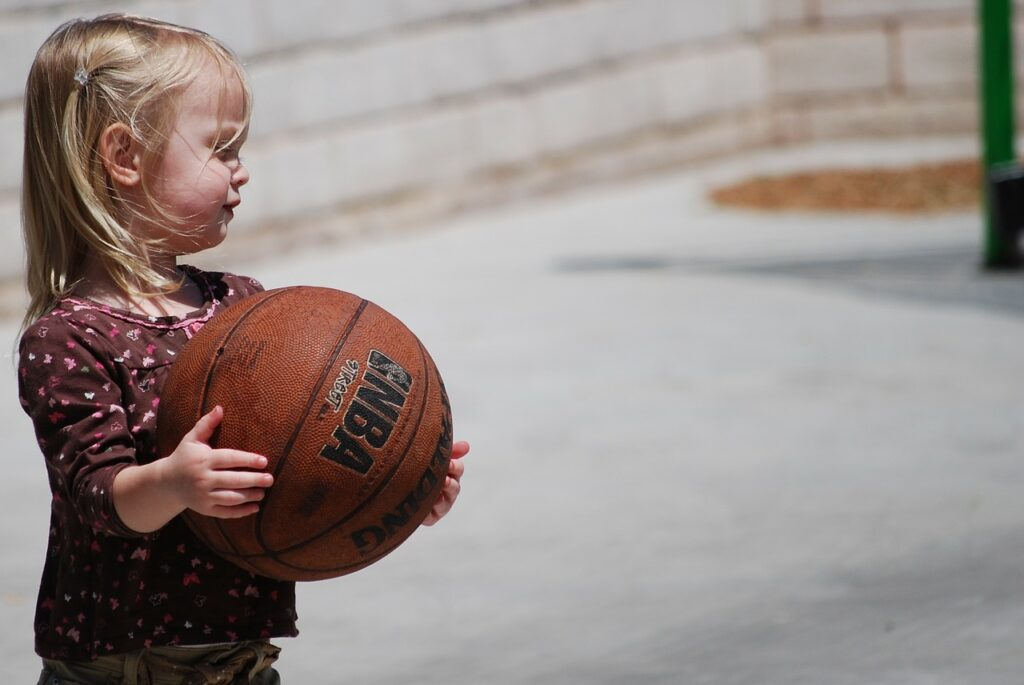 toddler with basketball
